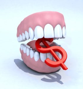 Dentures biting down on a dollar bill sign